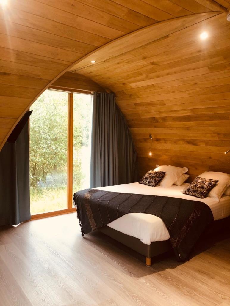 Chambre d'une cabane en bois Ecobane